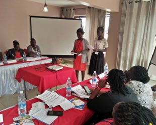 Linnet and alice of COMPE practising public speaking during the leadership training in Kamapla